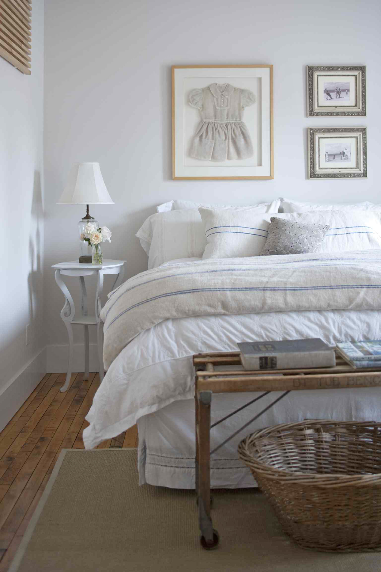 bedroom with white and blue linens
