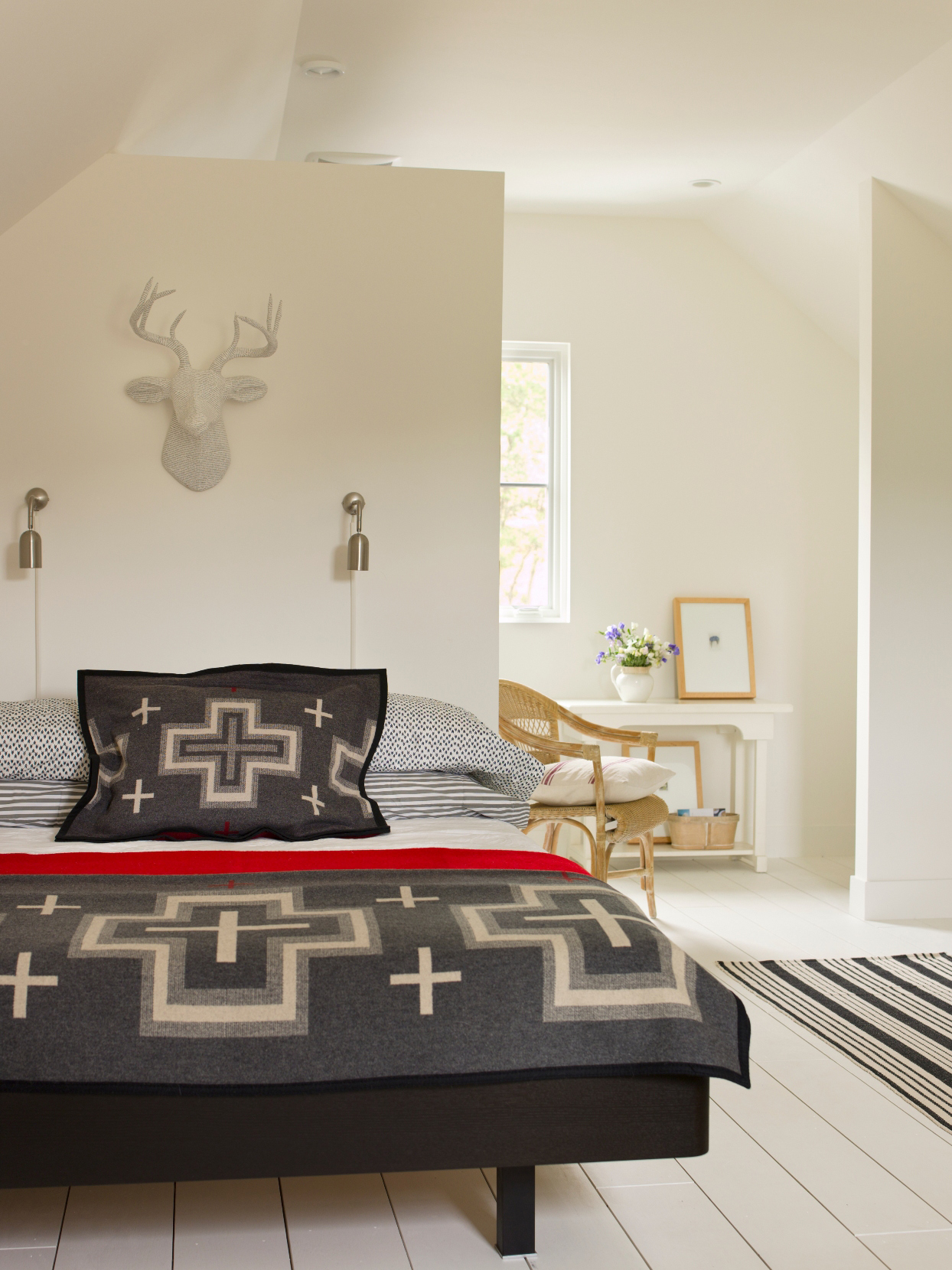 Modern eclectic bedroom with black and red accents