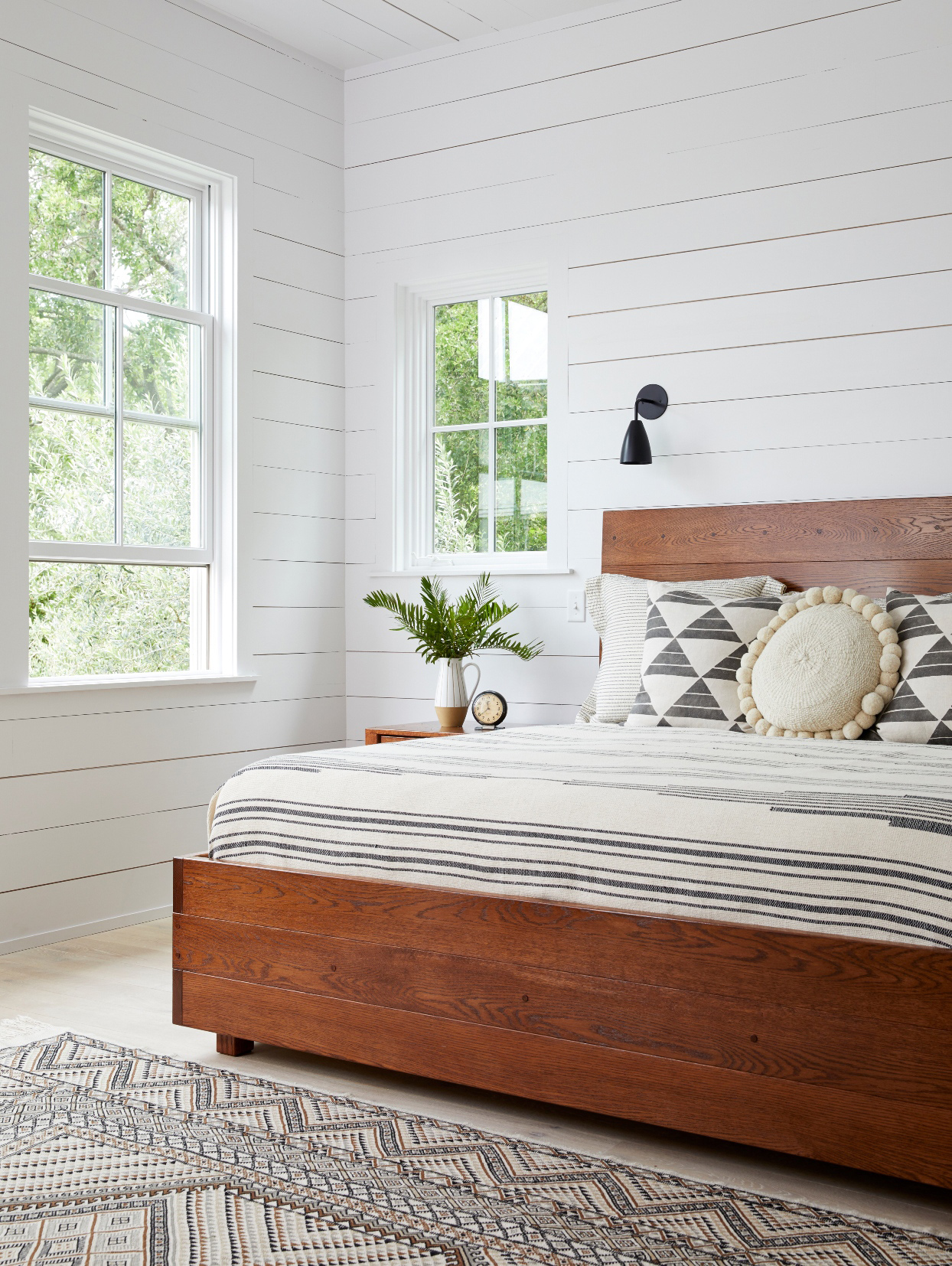 white bedroom with large wooden bed