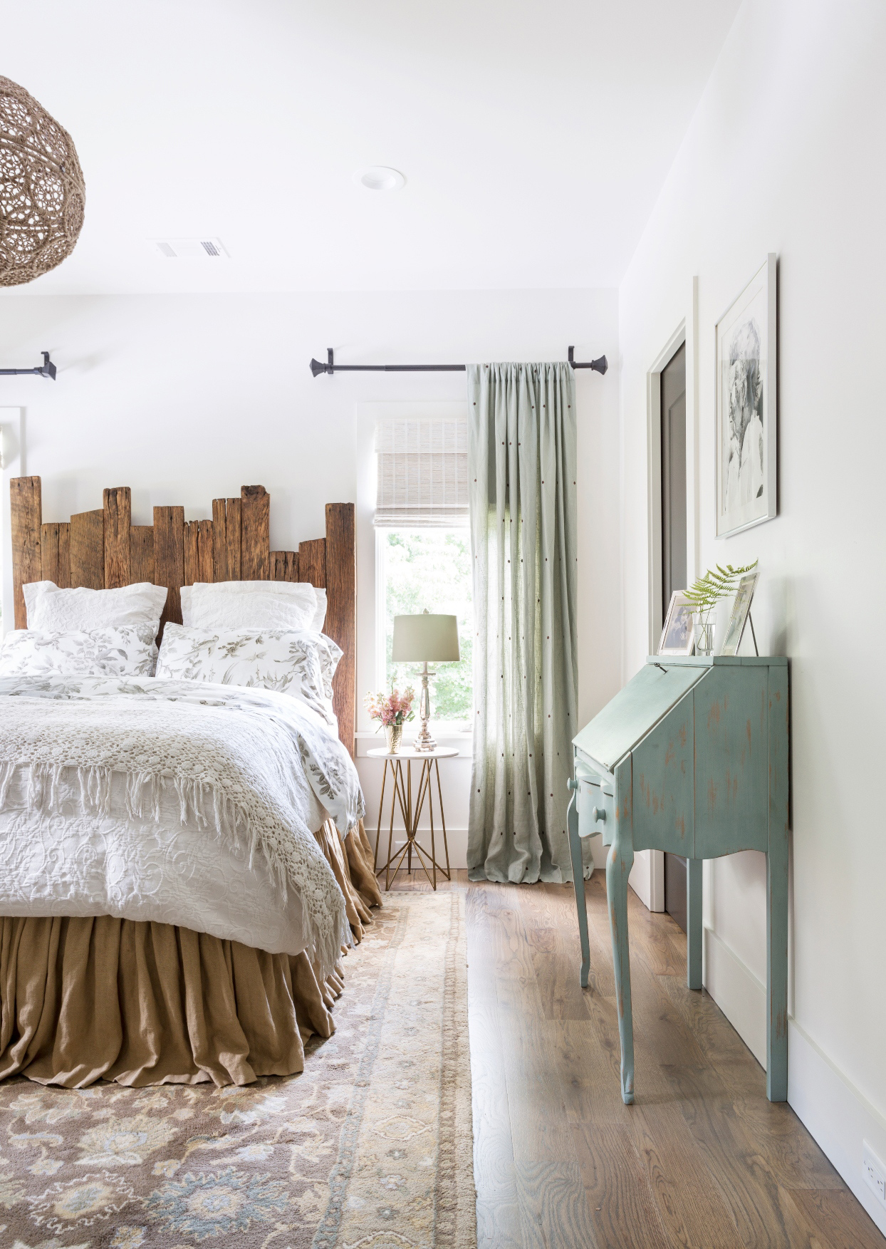 white and sea foam bedroom with wooden accents