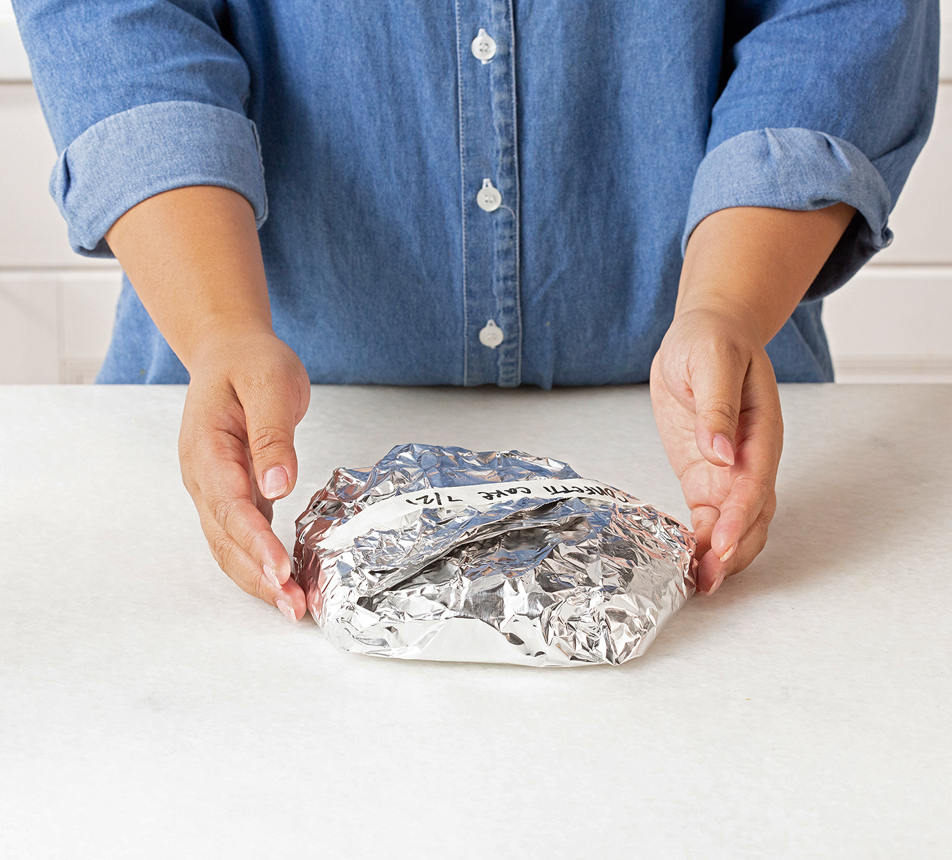 cake wrapped in foil and labeled to freeze