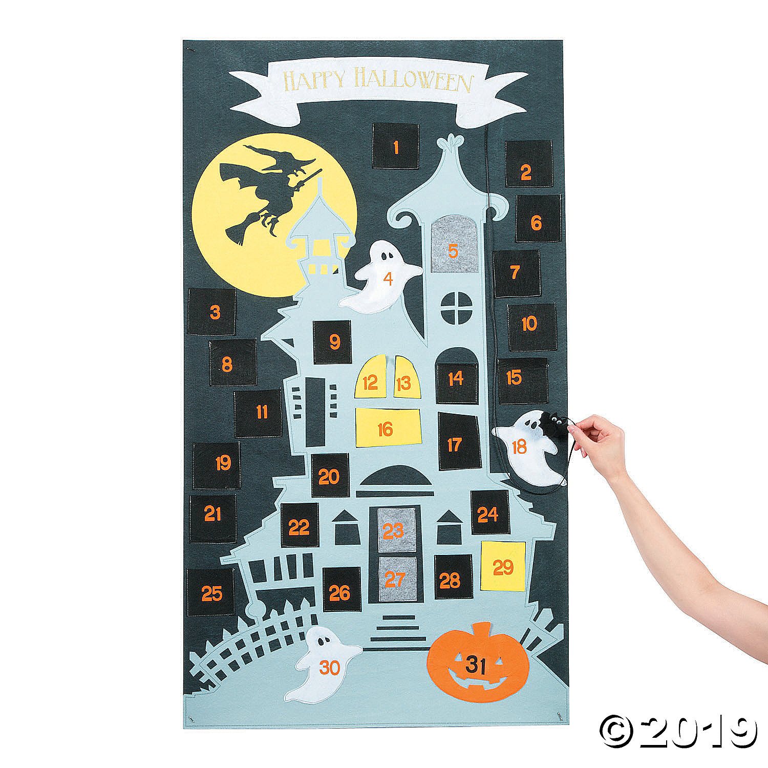 black and blue haunted House advent calendar with woman adding something to one of the pockets