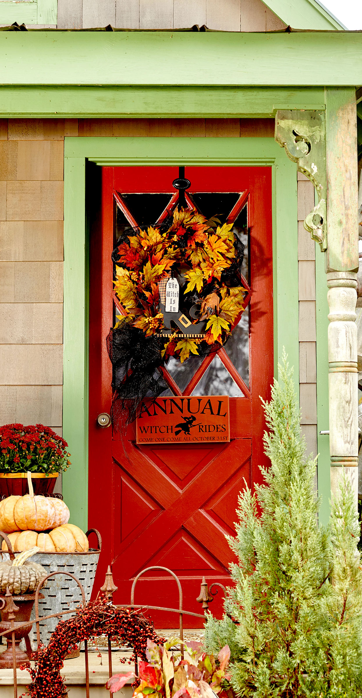 Red door with fall leaf wreath