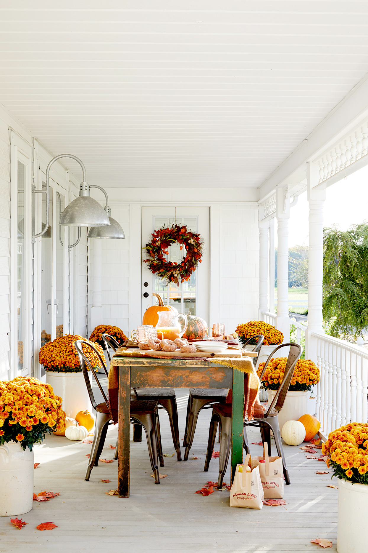 Fall table setting with wreath, marigolds