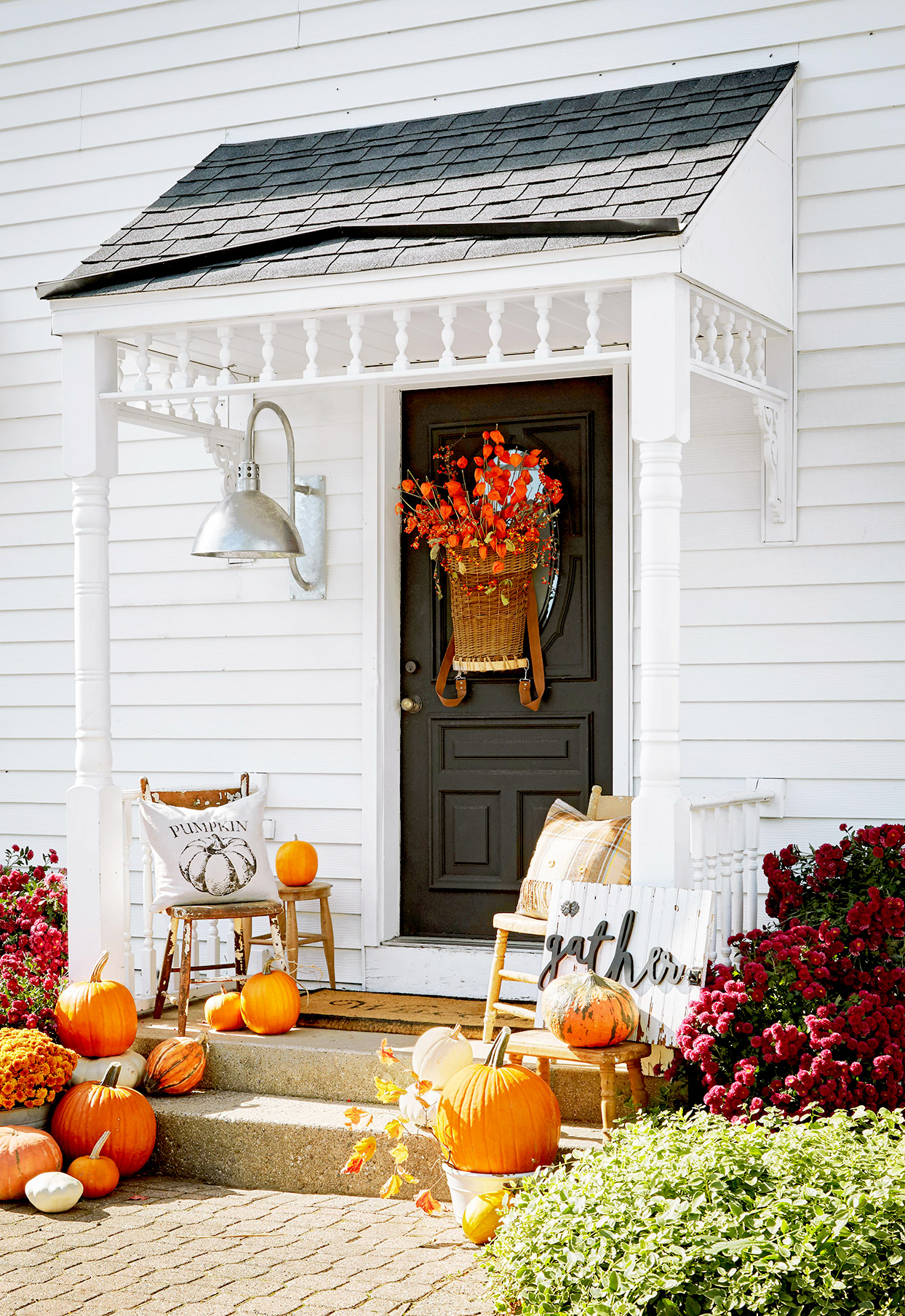 Front porch with pumpkins and fall décor