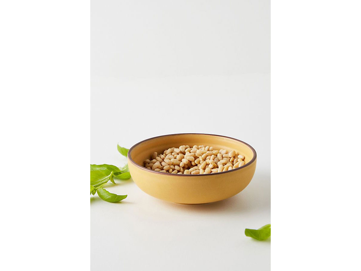 yellow bowl with nuts in it