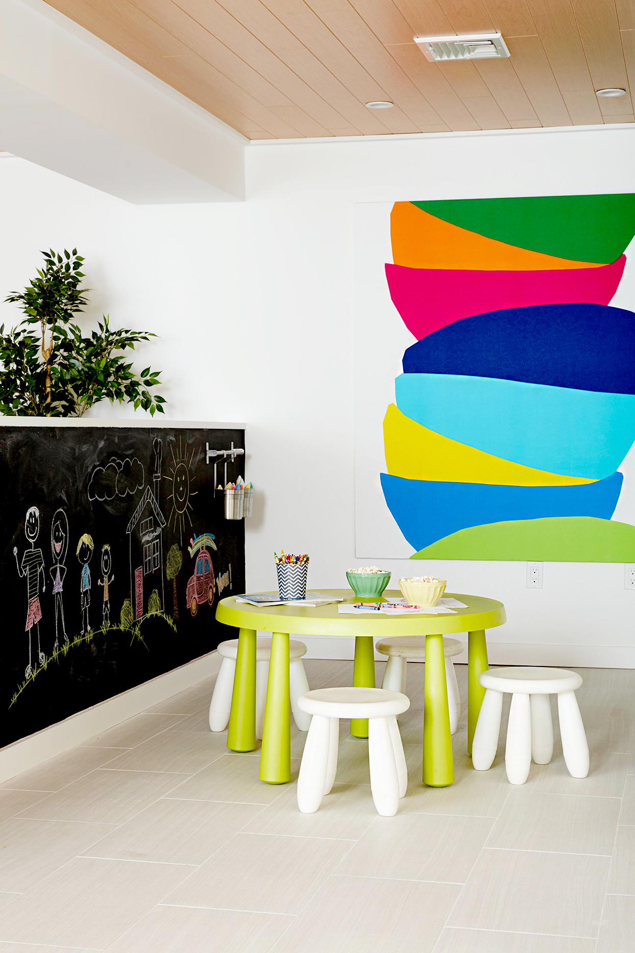 Child's dining area with colorful artwork