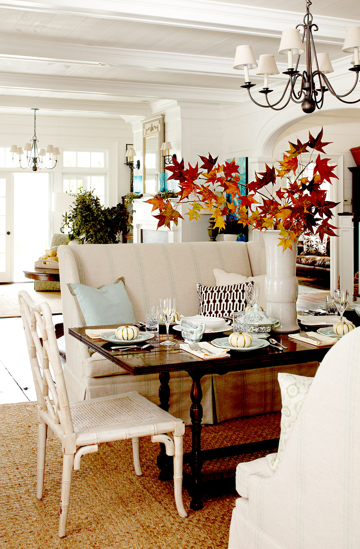 Dining area with fall leaf centerpiece and pumpkins