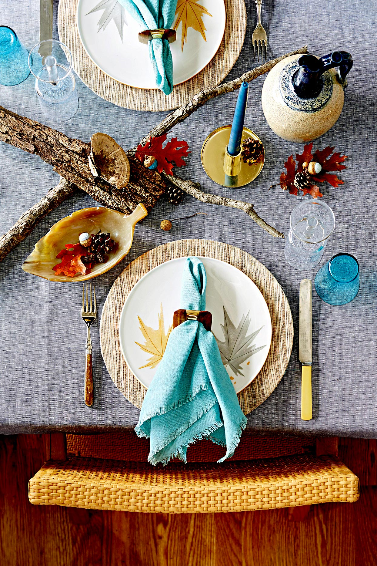 Fall table setting with leaves and branches