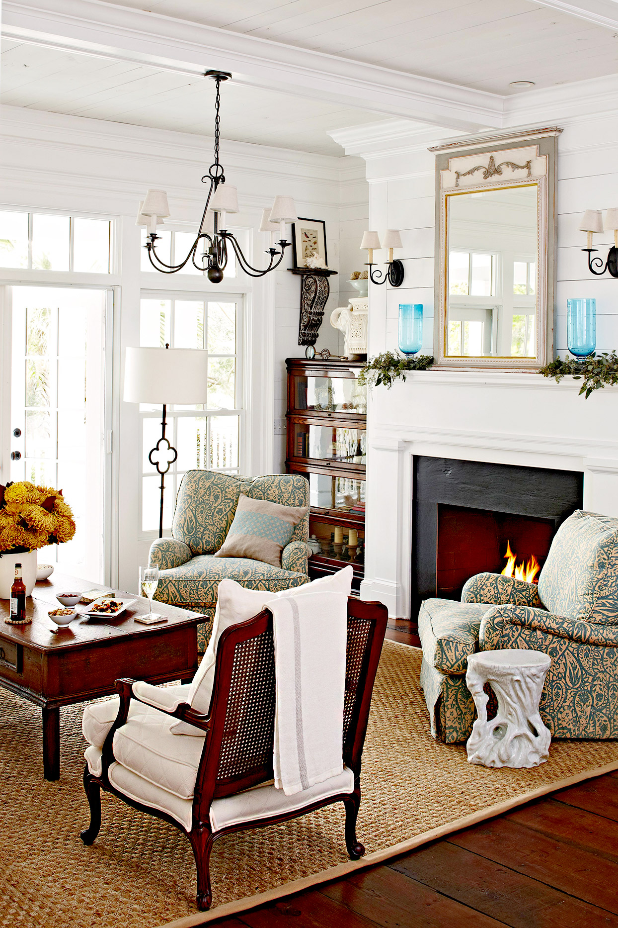 Living room with fireplace, chairs, and coffee table