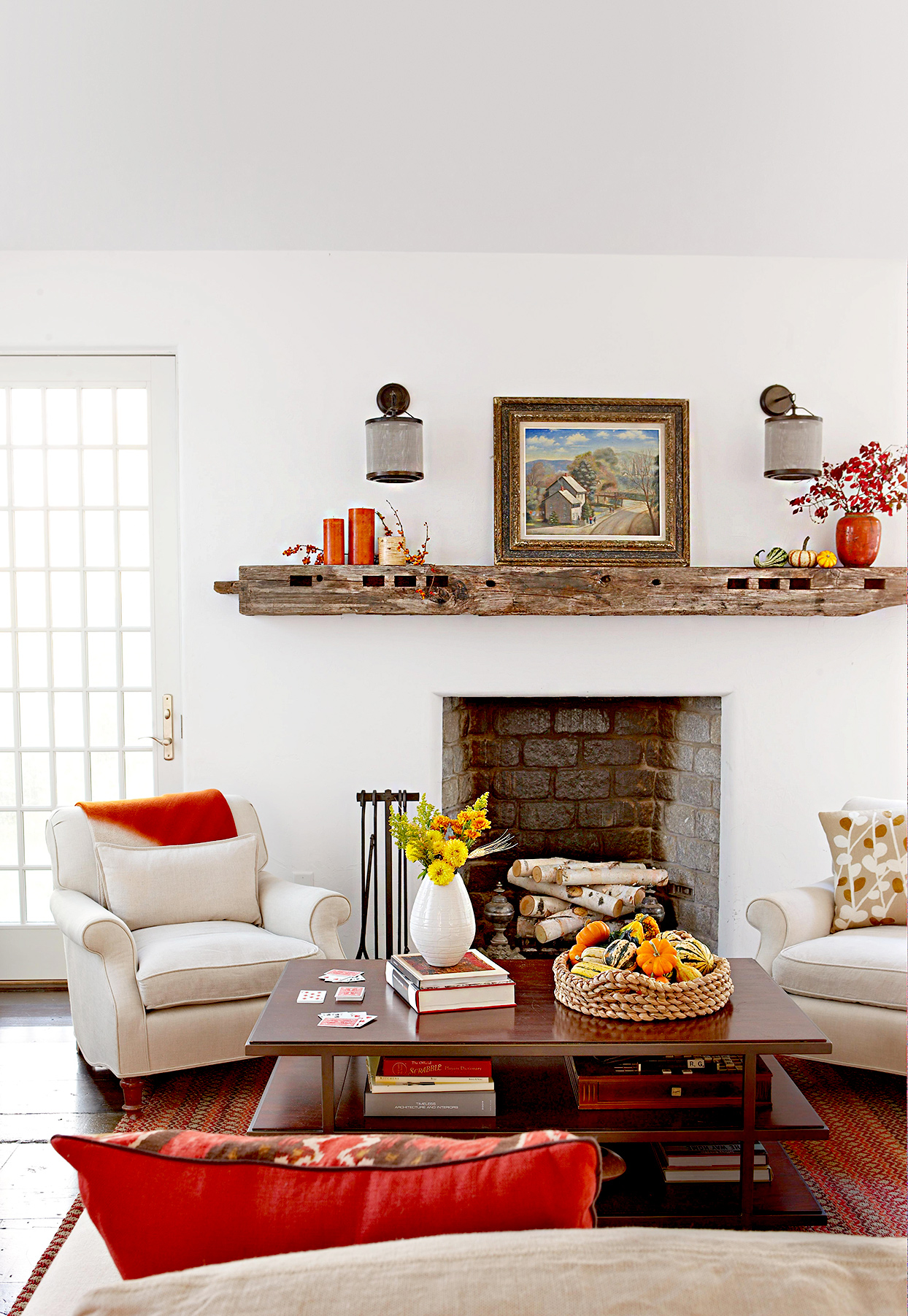 Living room with fireplace and fall décor