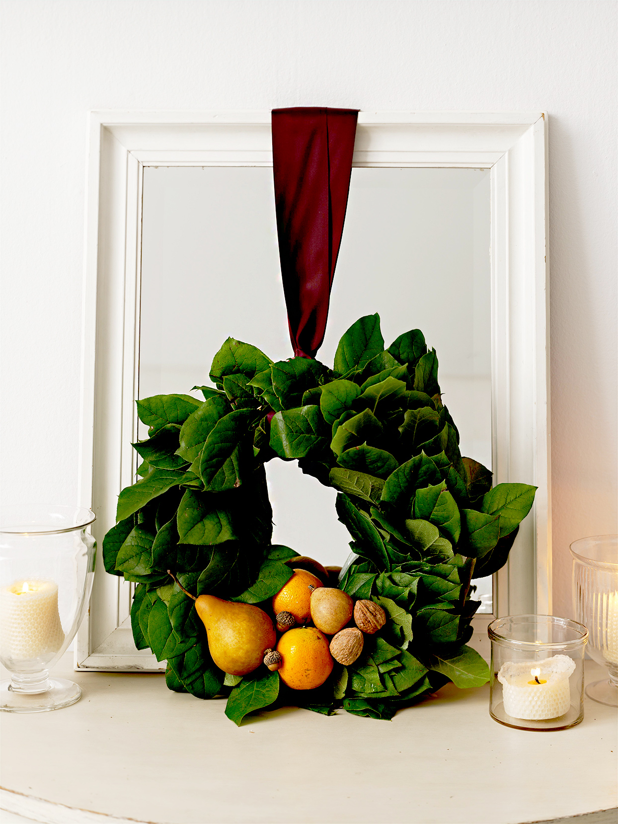 Wreath with dark green leaves and fruits