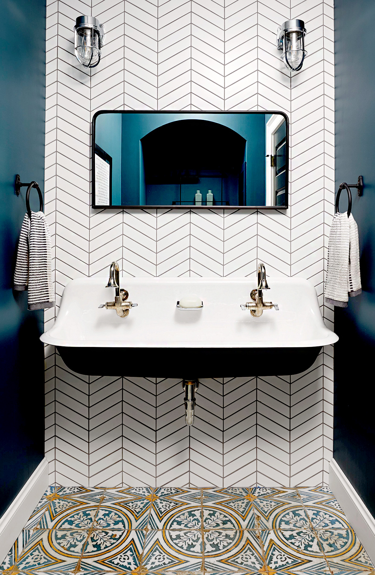 Double sink with geometric wallpaper