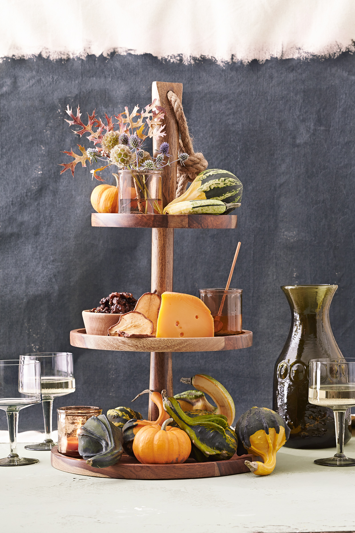 multi-tiered cheese appetizer platter
