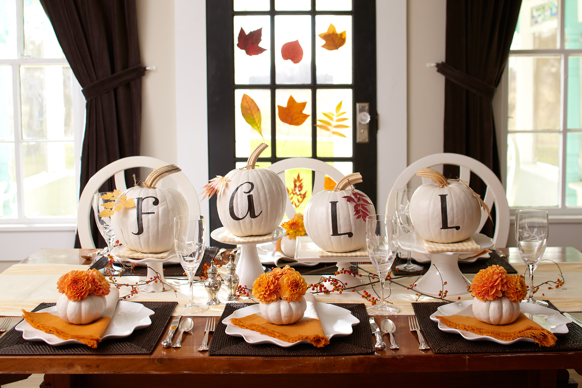 white-painted pumpkins with lettering spelling fall