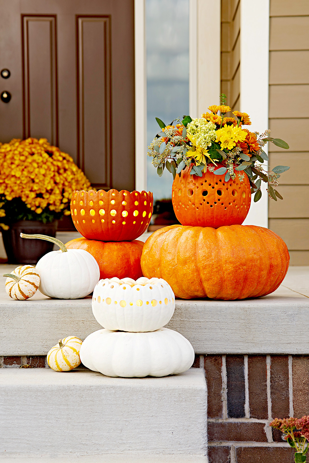 Front porch with pumpkins and planters