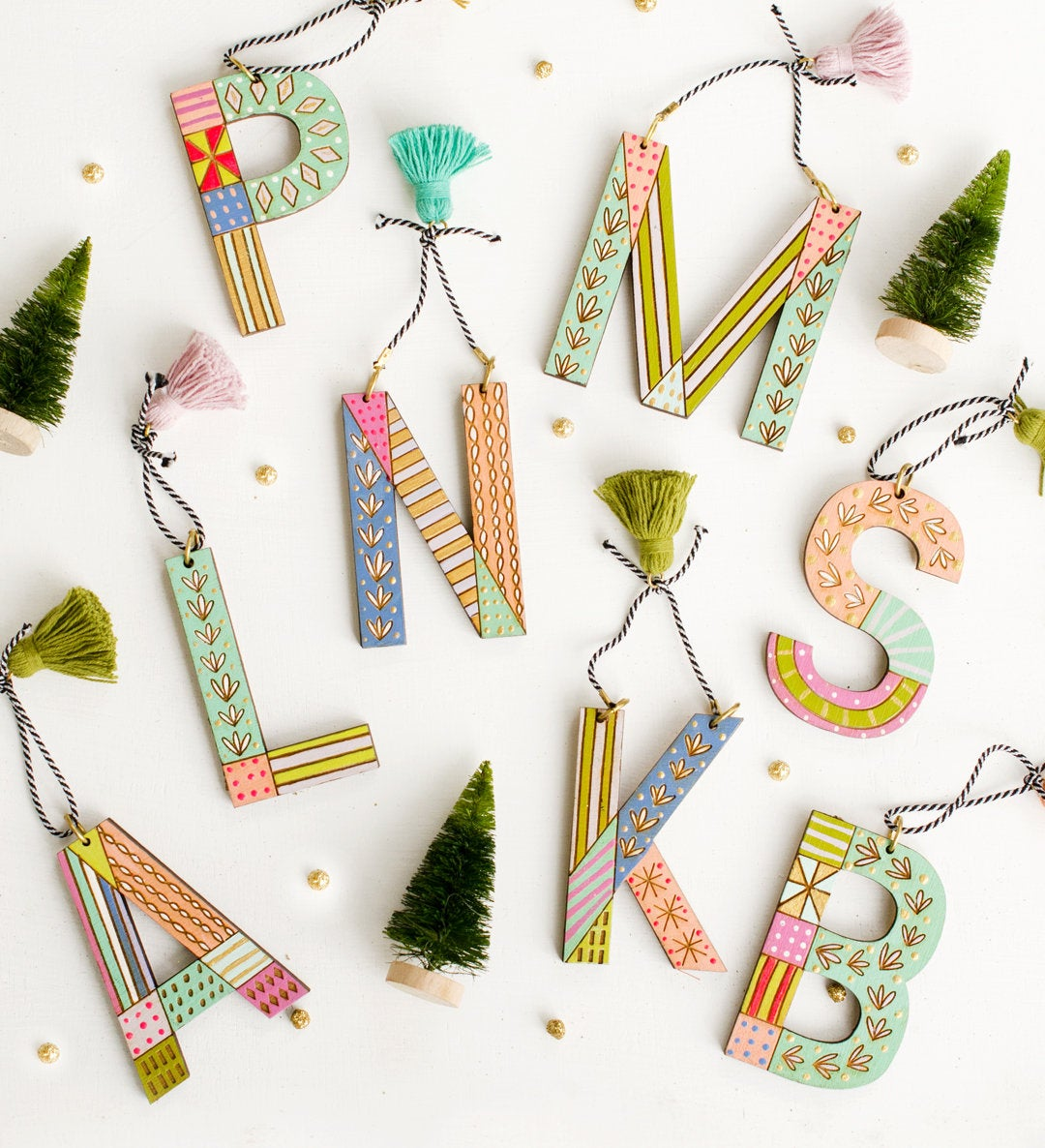 ornaments shaped like letters of the alphabet on a white surface