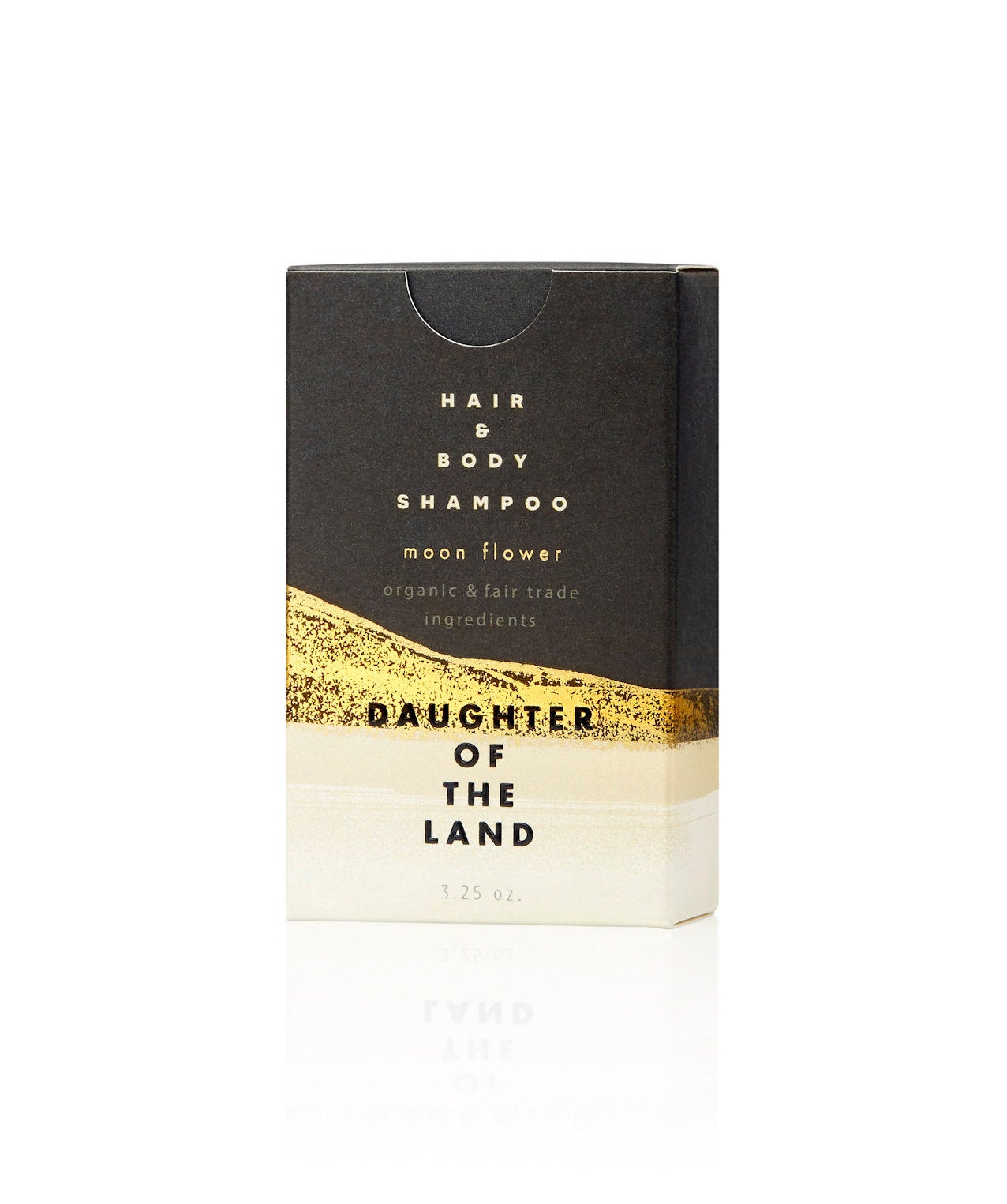 black and gold box that says shampoo bar on the front