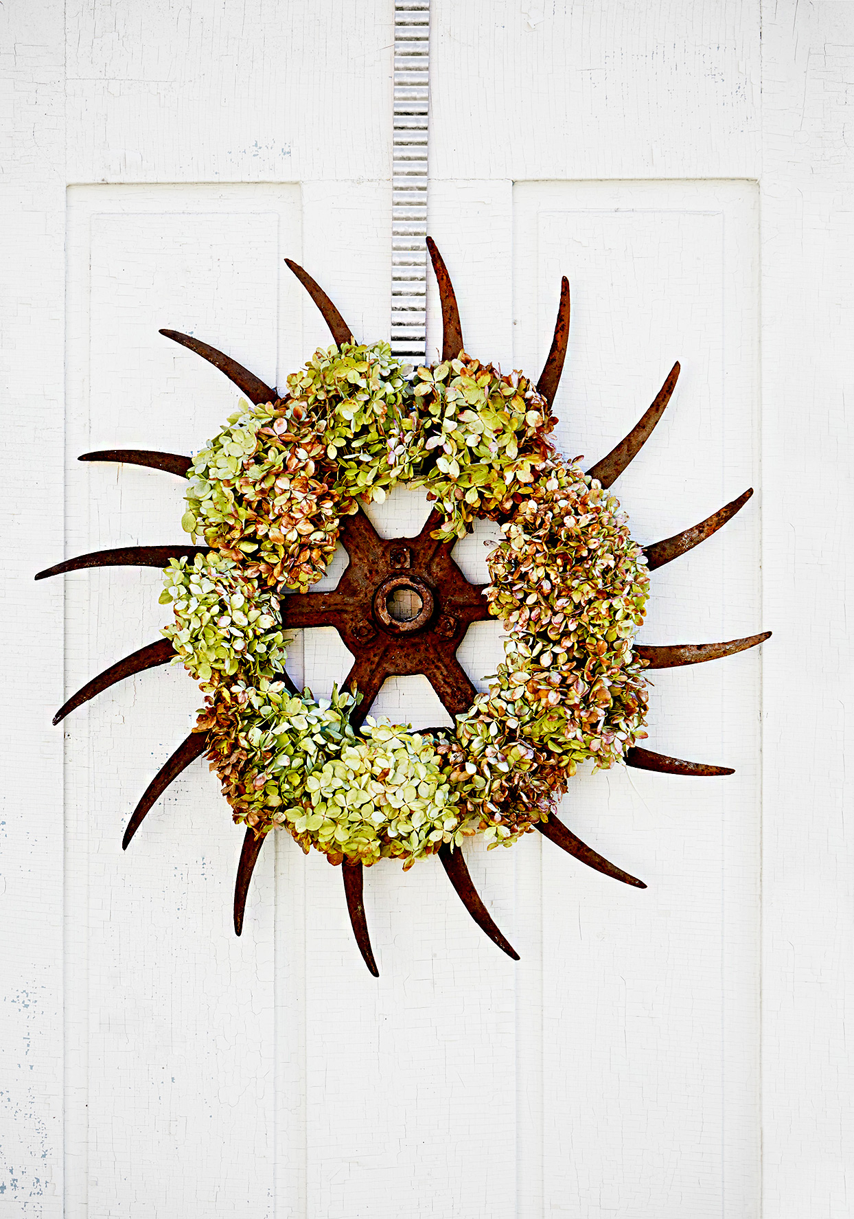 Circular metal wreath with plants