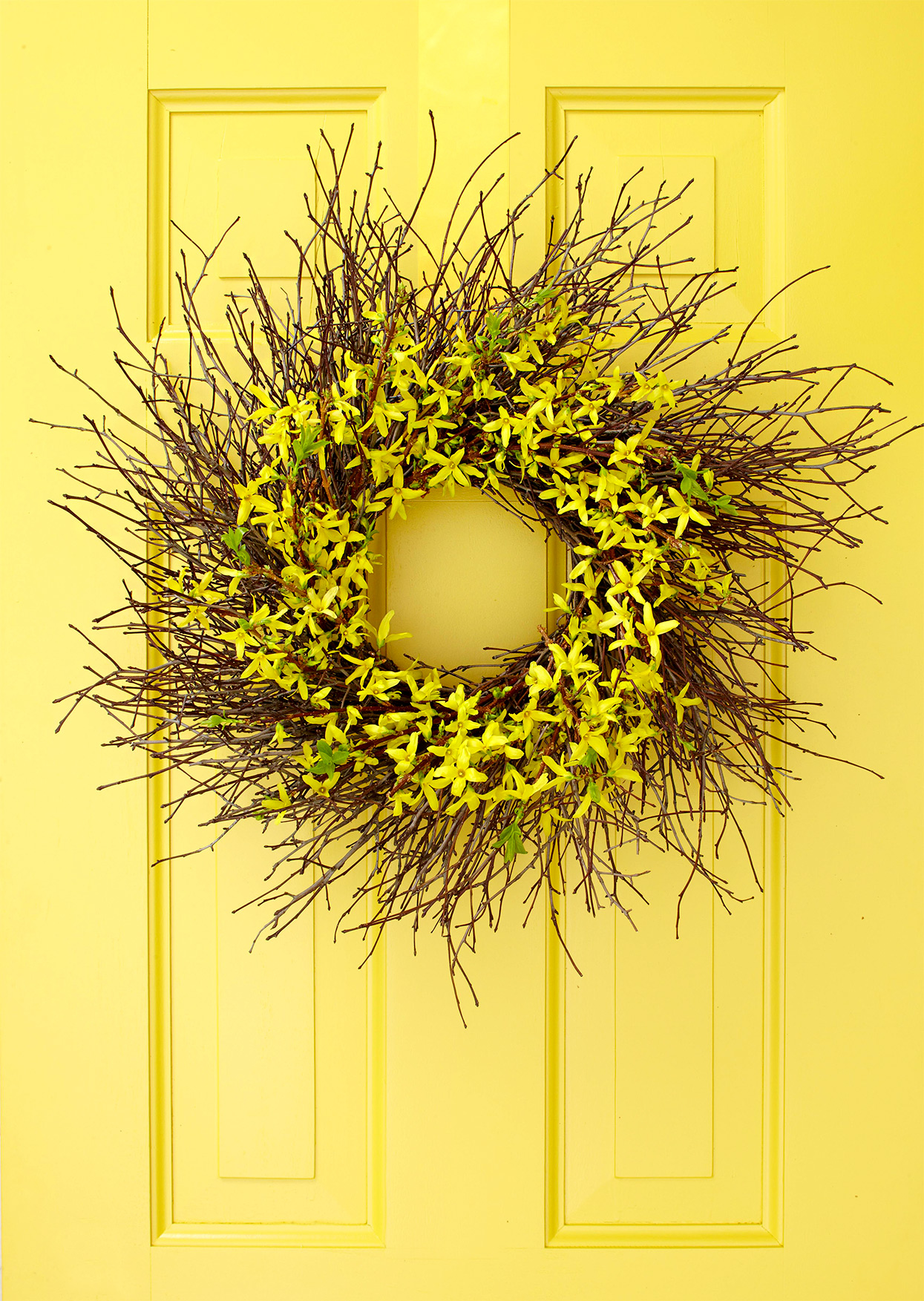bright yellow door with fall wreath