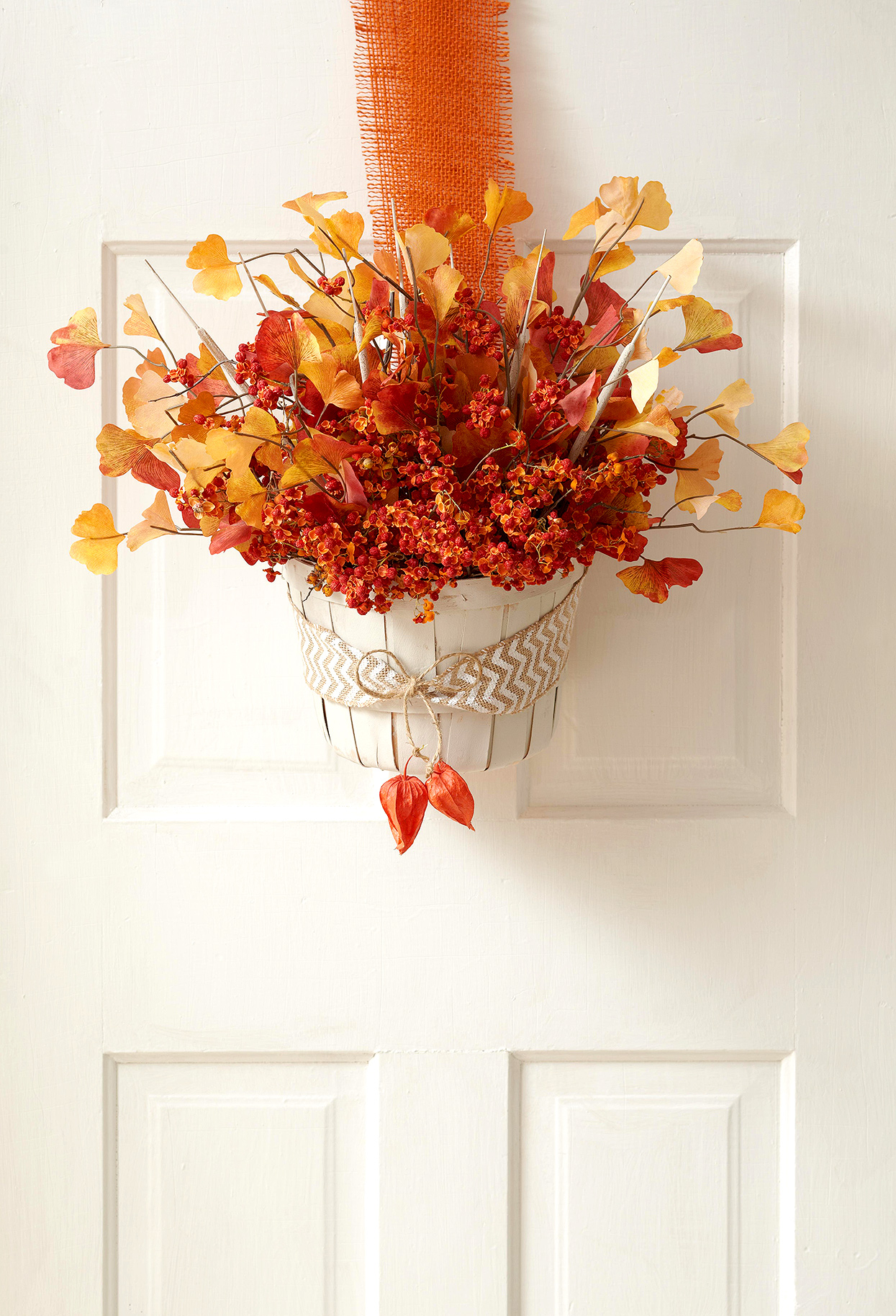 fall basket hanging from door with gingko