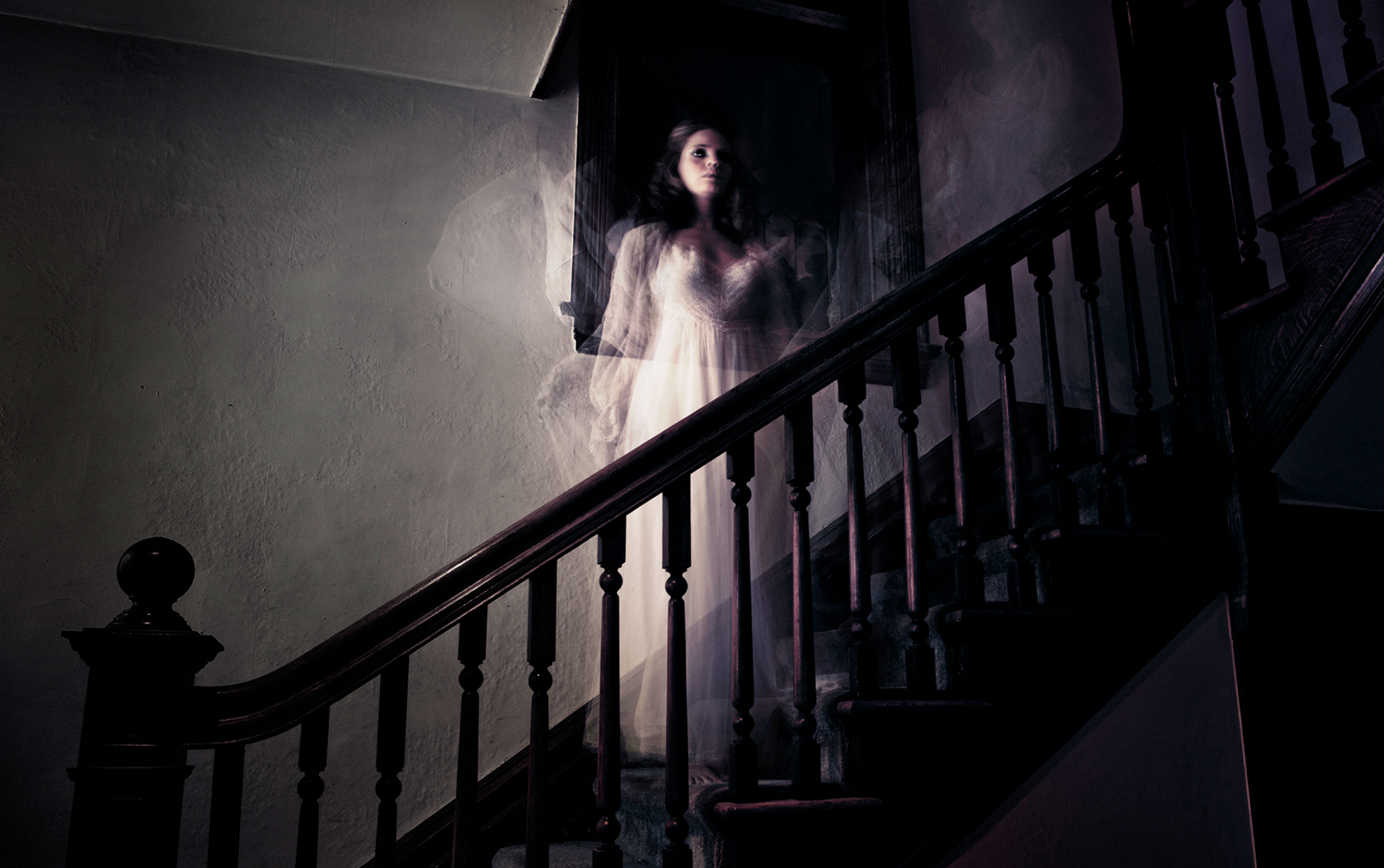 ghosty woman on the stairs in a paranormal house