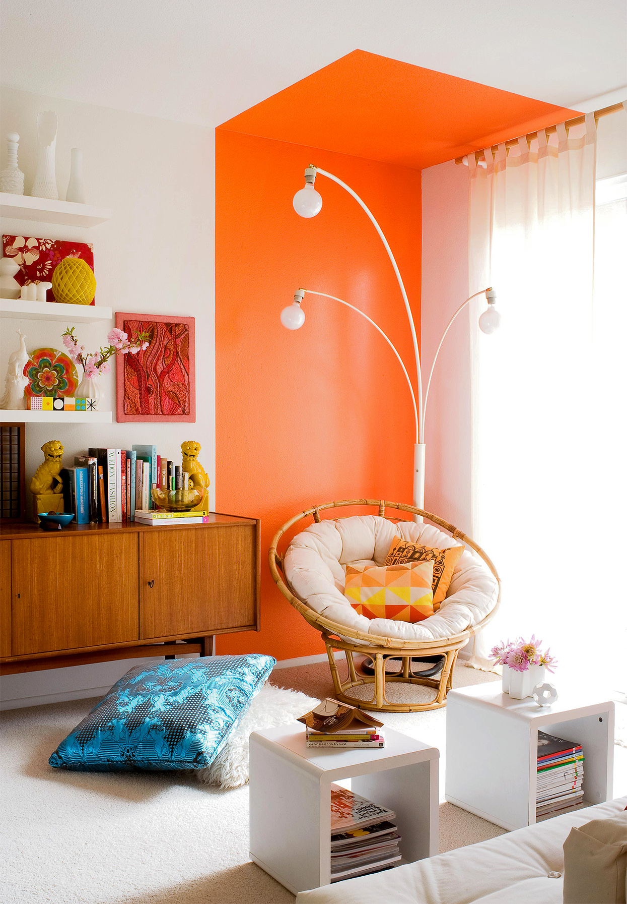 room corner with bright orange two-toned paint and papasan chair