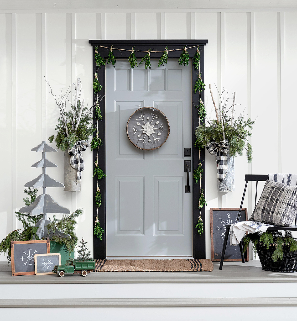 modern farmhouse Christmas porch with birch and vintage elements