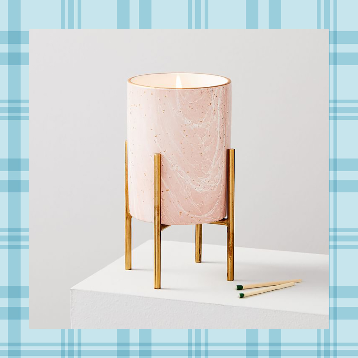 west elm candle on a stand
