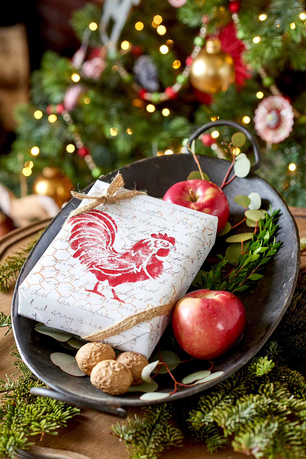 black tray with apples and rustic rooster stamped package