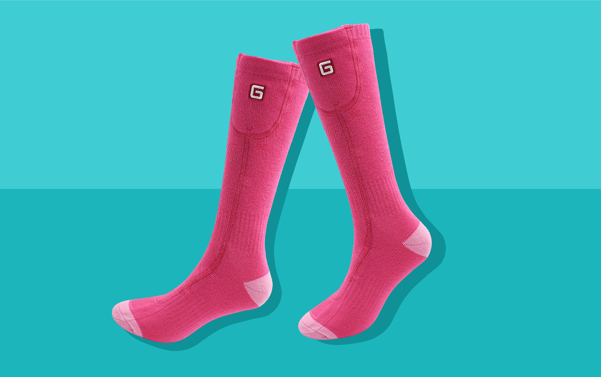 two pink heated socks on a teal background
