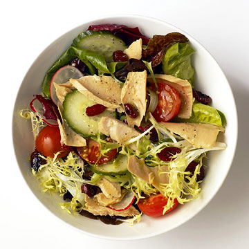 Bagged lettuce, canned salmon or tuna, veggies, dried cranberries, and reduced-fat salad dressing