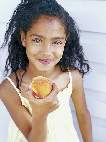 girl holding peach