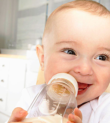 baby drinking out of bottle