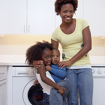 family in front of washing machine