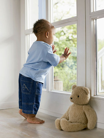 toddler looking out window