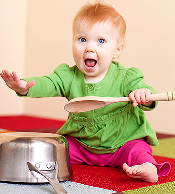 Baby playing with pots and pans