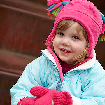 toddler wearing winter hat and gloves