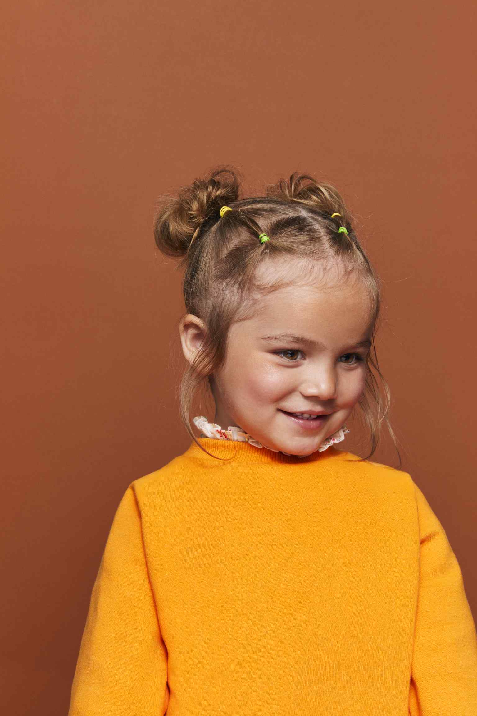 Girl Hairstyle with Buns