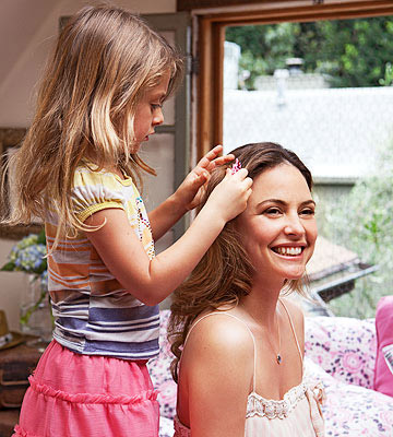 child playing with mother's hair