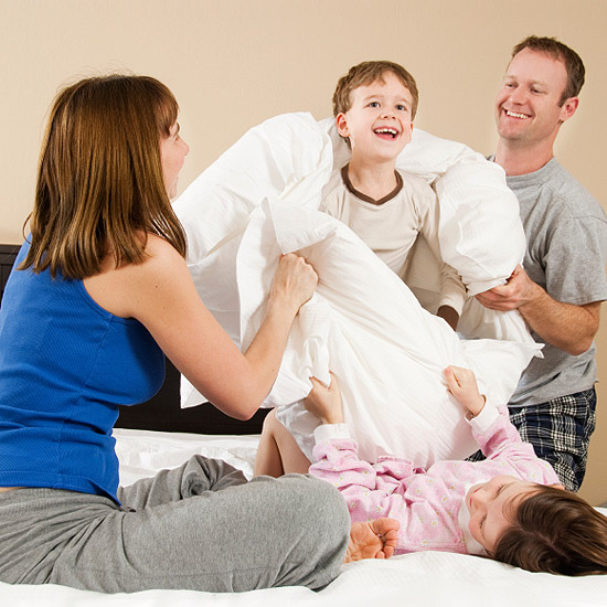 Family hotel pillow fight