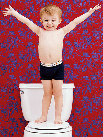 Child standing on the toilet