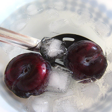 plums in ice bath