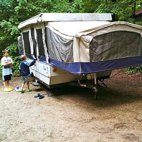 kids by the camper