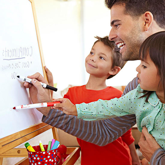 father coloring with children