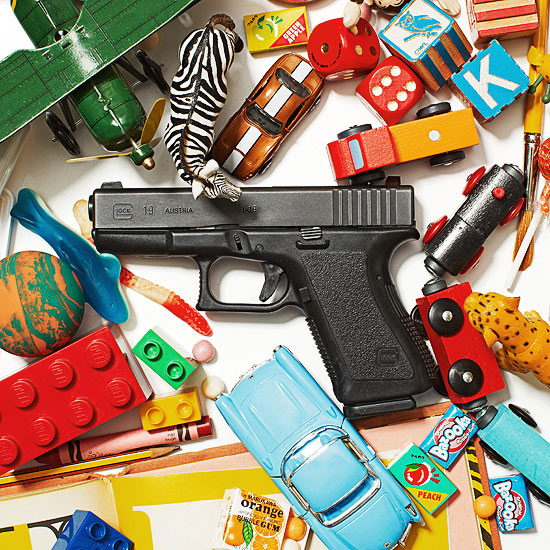 Gun surrounded by toys and candy