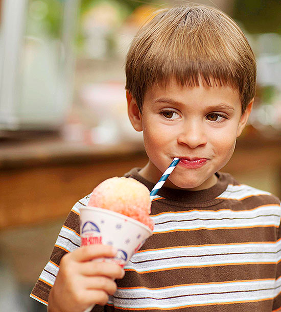 child eating snow cone