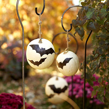 Bat painted white pumpkins