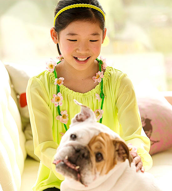 child with pet dog
