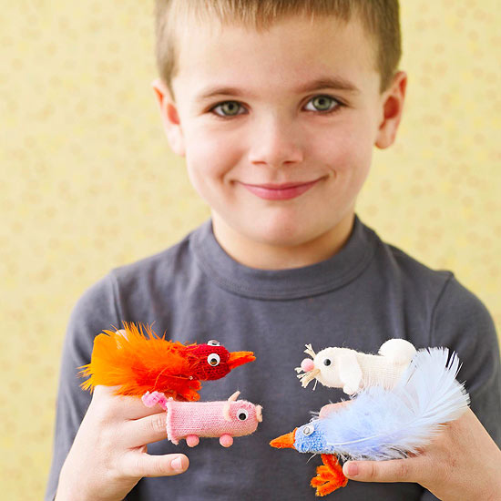 child with finger puppets
